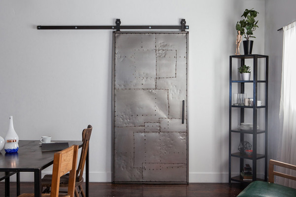 Scrap metal Sliding barn door from https://rusticahardware.com